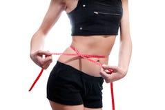 Kvinna som gör vikt- & midjackeck   Royaltyfria Foton