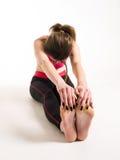 Kvinna som gör yogaövning Fotografering för Bildbyråer
