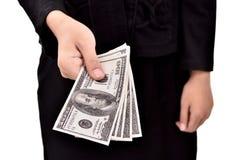 Kvinna som ger mycket pengar Royaltyfria Foton