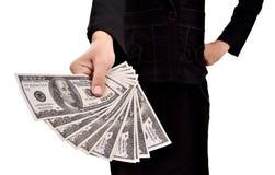 Kvinna som ger mycket pengar Royaltyfria Bilder