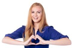 Kvinna som gör en hjärta att göra en gest Royaltyfri Bild