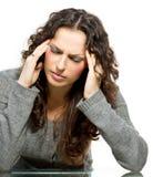 Kvinna som har huvudvärk Royaltyfria Foton