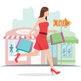 Kvinna som kör med shoppingpåsar Royaltyfria Bilder