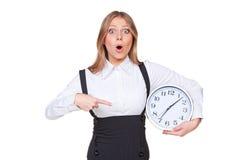 Kvinna som pekar på klockan Royaltyfri Fotografi