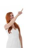 Kvinna som pekar till övrehögerhörnet Royaltyfri Foto