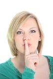 Kvinna som quiet ber med hyssja gest royaltyfri bild