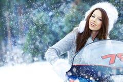 kvinna som rider en snowmobile Royaltyfri Fotografi