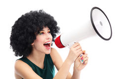 Kvinna som ropar till och med megafonen Fotografering för Bildbyråer