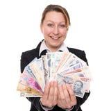 Kvinna som rymmer brett handlade valutor Royaltyfria Bilder