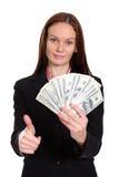 kvinna som rymmer en räkning för dollar 100 royaltyfri foto