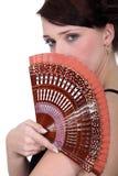 Kvinna som rymmer en ventilator Arkivfoton