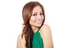 Kvinna som rymmer hennes starka hår royaltyfri foto