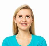 Kvinna som ser upp över vit bakgrund Arkivfoton