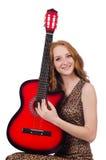 Kvinna som spelar den isolerade gitarren Royaltyfri Foto