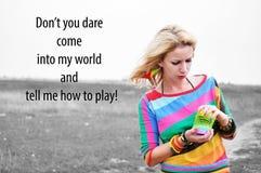 Kvinna som spelar med den färgrika plast- våren Fotografering för Bildbyråer