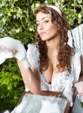Kvinna som tvättar sig i trädgård Fotografering för Bildbyråer