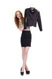 Kvinna som väljer den isolerade klänningen Royaltyfri Foto