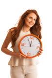 Kvinna som visar en klocka som ett tecken av tidledning Royaltyfria Bilder