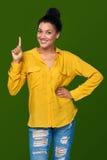 Kvinna som visar ett finger Fotografering för Bildbyråer