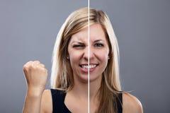 Kvinna som visar ilsket och lyckligt uttryck arkivfoto