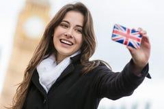 Kvinna turist- tagande Selfie vid Big Ben, London, England Arkivbild