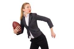 Kvinnaaffärskvinnan med amerikansk fotboll Arkivbild
