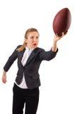 Kvinnaaffärskvinnan med amerikansk fotboll Arkivfoto
