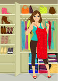 Kvinnaanseende nära en garderob vektor illustrationer