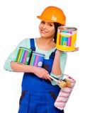 Kvinnabyggmästare med konstruktionshjälpmedel Fotografering för Bildbyråer