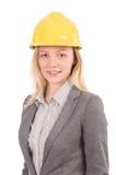 Kvinnabyggnadsarbetare med den isolerade hårda hatten Arkivfoto