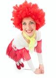 Kvinnaclown med rött hår Arkivbild
