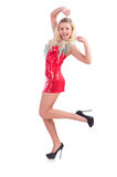 Kvinnadans i den isolerade röda klänningen Fotografering för Bildbyråer