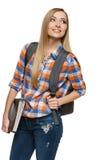 Kvinnadeltagareanseende med ryggsäckinnehavmappen arkivbild