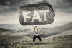 Kvinnaelevatorsten med fett ord i kullar Arkivbilder