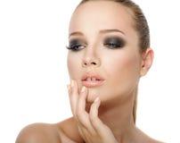 Kvinnaframsida med rökigt Royaltyfria Bilder