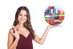 Kvinnahållboll med landsflaggor Arkivbild
