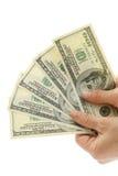 Kvinnahand med 100 dollarräkningar Royaltyfri Foto