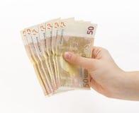 Kvinnahand med pengar (euroet) Arkivbilder