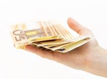 Kvinnahand med pengar (euroet) royaltyfri fotografi