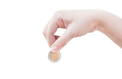 Kvinnahand som sätter ett isolerat mynt på vit bakgrund royaltyfri fotografi