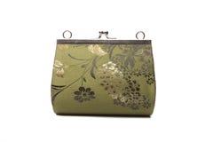 Kvinnahandväska med blommaprydnadtextilen Arkivfoto