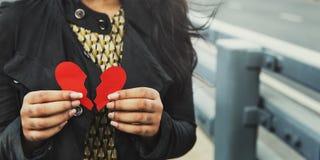 Kvinnahjärta som bryter före dettaförhållandebegrepp Fotografering för Bildbyråer