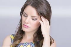 Kvinnahuvudvärk Arkivfoton