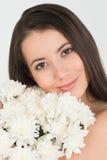Kvinna med blommor Arkivbild