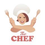 Kvinnakock Härlig kock med den träskeden och gaffeln arkivfoto