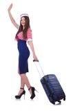 Kvinnaloppdeltagare med resväskan Arkivbild