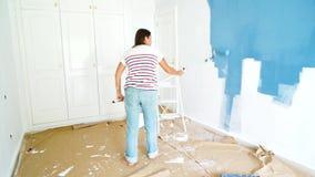 Kvinnamålningvägg lager videofilmer