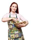 Kvinnamatlagning och bakning Arkivbilder