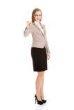 Kvinnamedel som rymmer tangenterna Royaltyfria Bilder