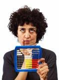 Kvinnan beräknar med kulrammet Fotografering för Bildbyråer